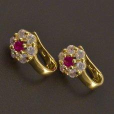 Goldene mädchenhafte Ohrringe einer Blume
